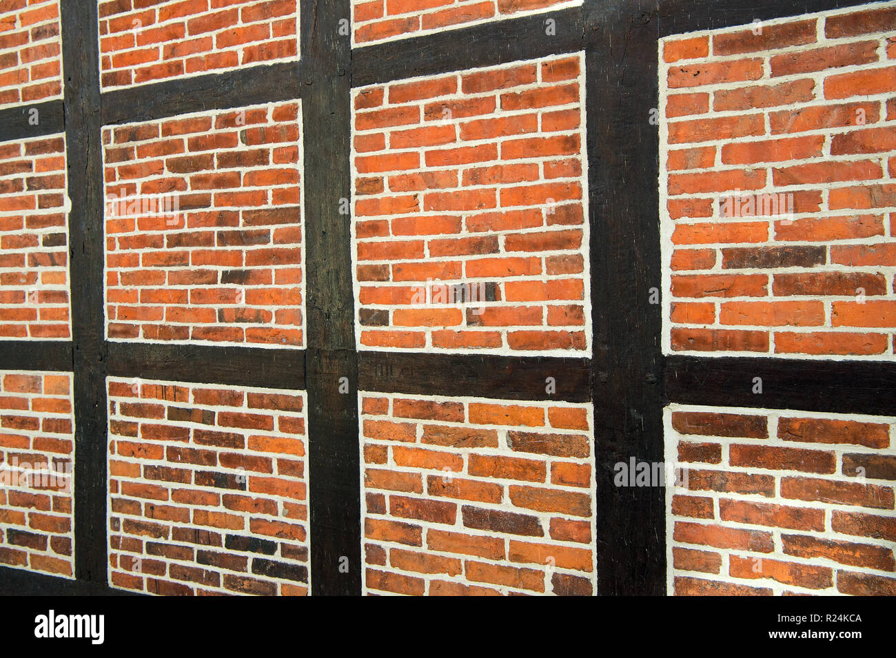 Architecture, construction and building concept. House wall of red bricks and wood textured surface on brickwork background. - Stock Image