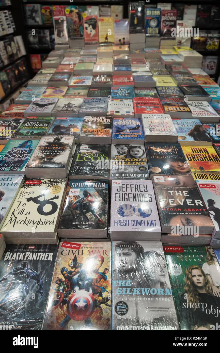 Jakarta, Indonesia - November 13 2018: Various paperback novels displayed in a modern bookstore. - Stock Image