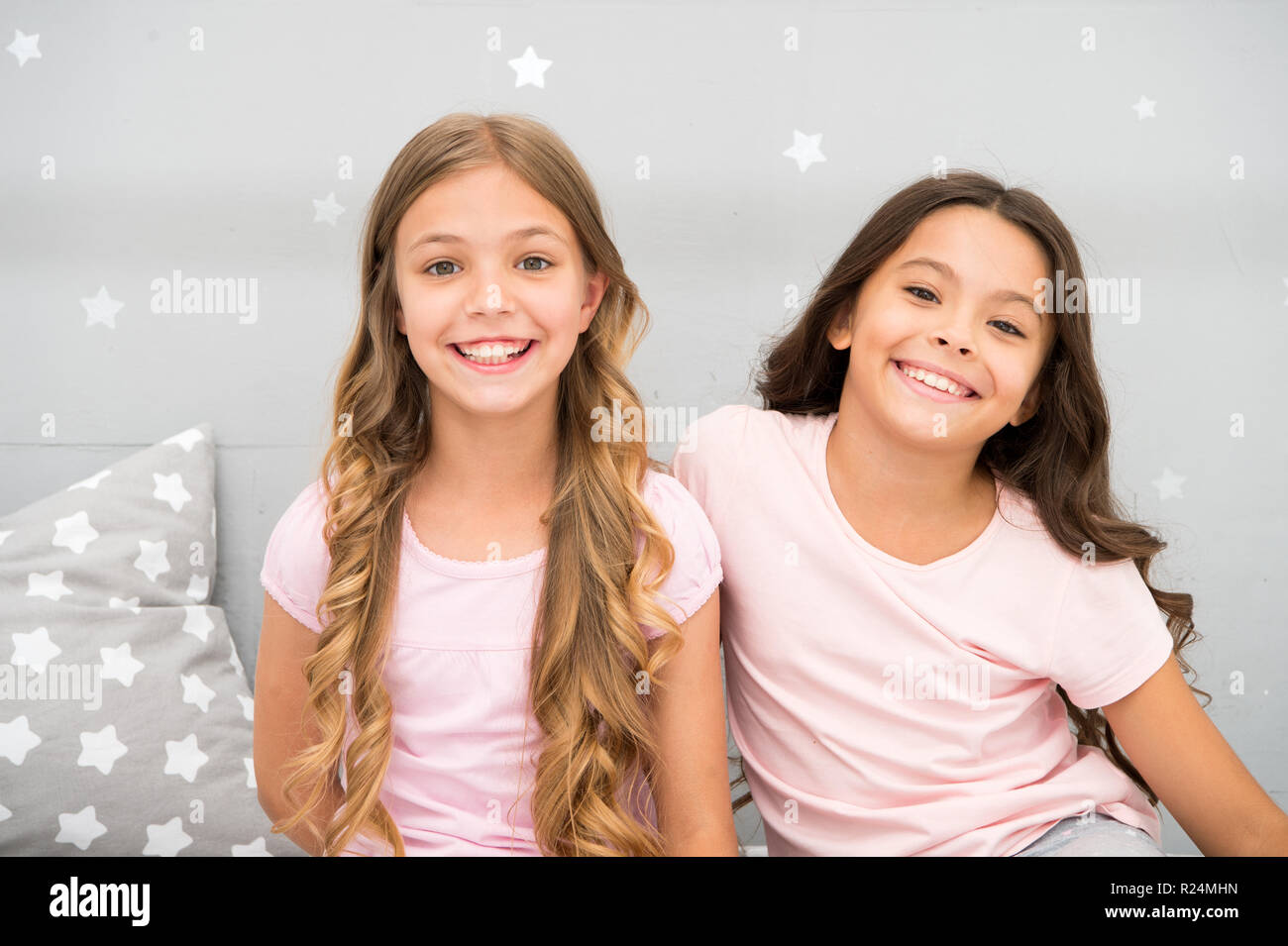Girls children with long curly hair. Pajamas party concept. Girls just want to have fun. Girlish secrets honest and sincere. Friends kids have nice time pleasant leisure. Best friends forever. Stock Photo