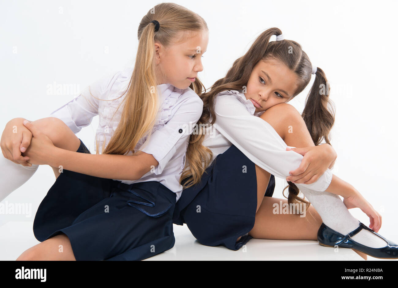 Supportive friend. Girl upset result knowledge test. Schoolgirls cute hairstyle sit desk. Best friends free relaxing after difficult test. Schoolgirls tidy fancy hair supportive conversation. - Stock Image