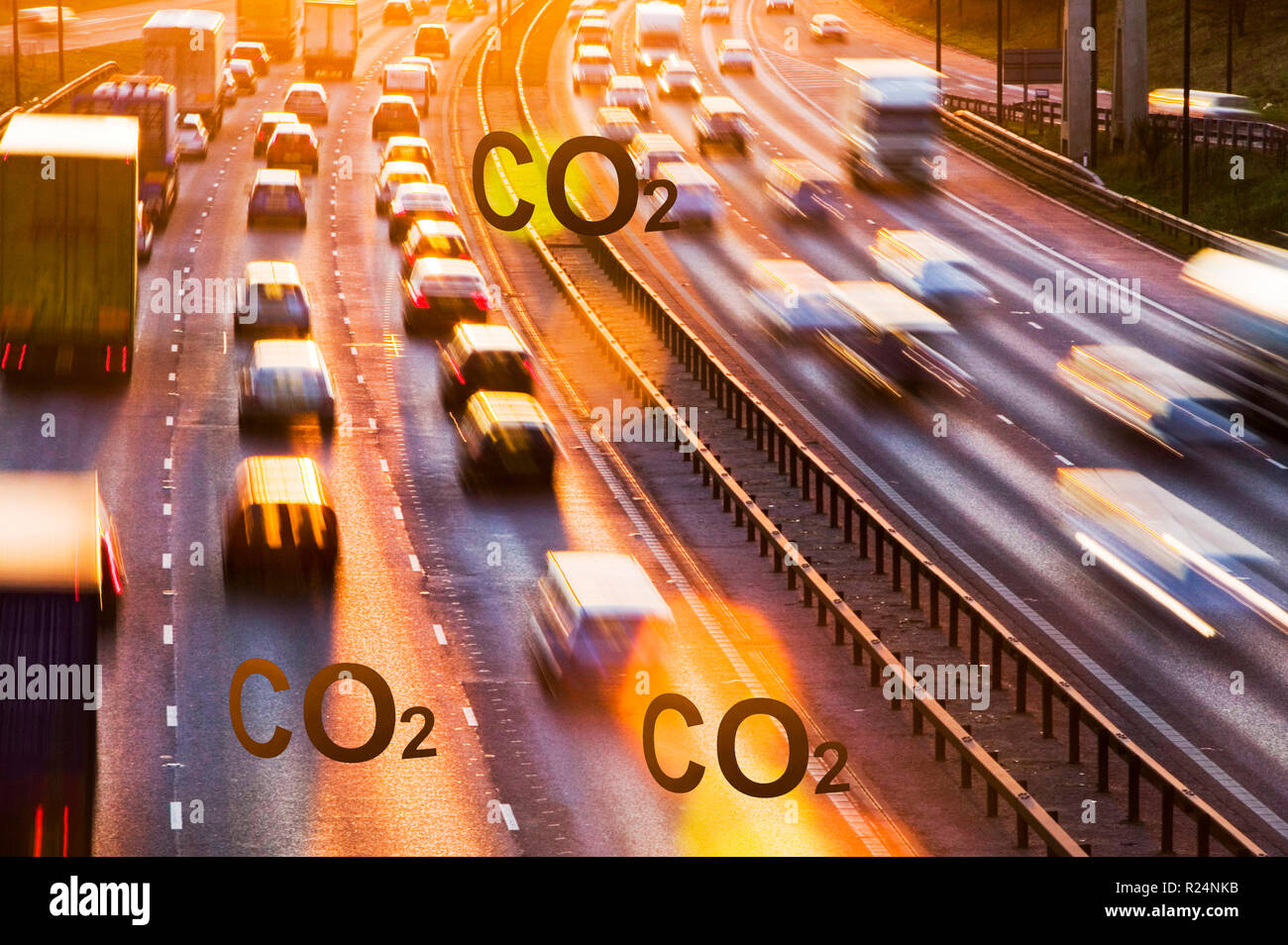 Rush hour traffic on the M60 motorway near Manchester at sunset, UK. Consumption of one gallon of petrol emits around 10.2 Kg of C02. - Stock Image