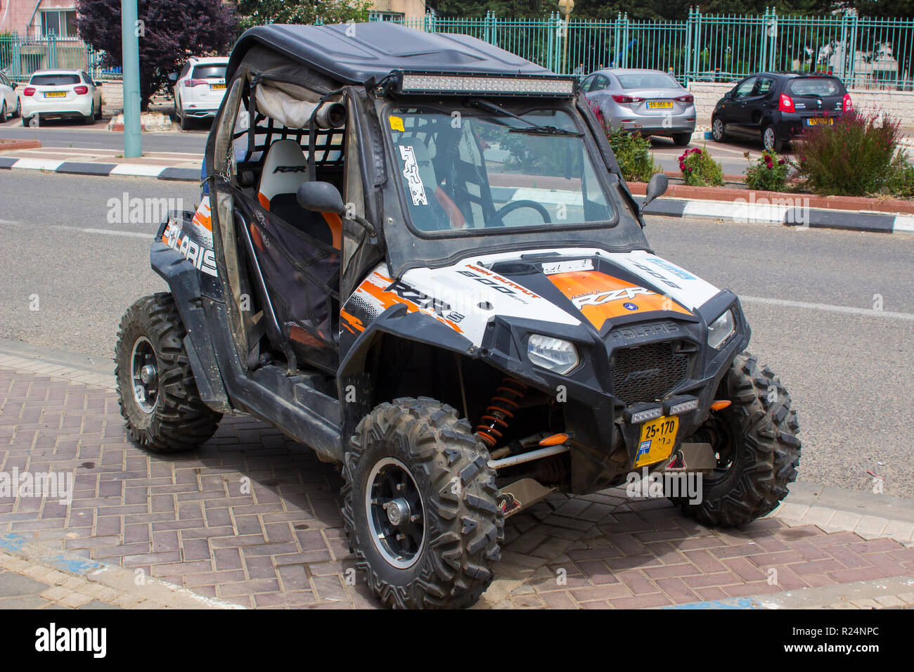 4 May 2018 A Polaris Razor off road petrol power vehicle parked on the main street of Buqata a small Druze Arab town in the Golan Heights North Israel - Stock Image