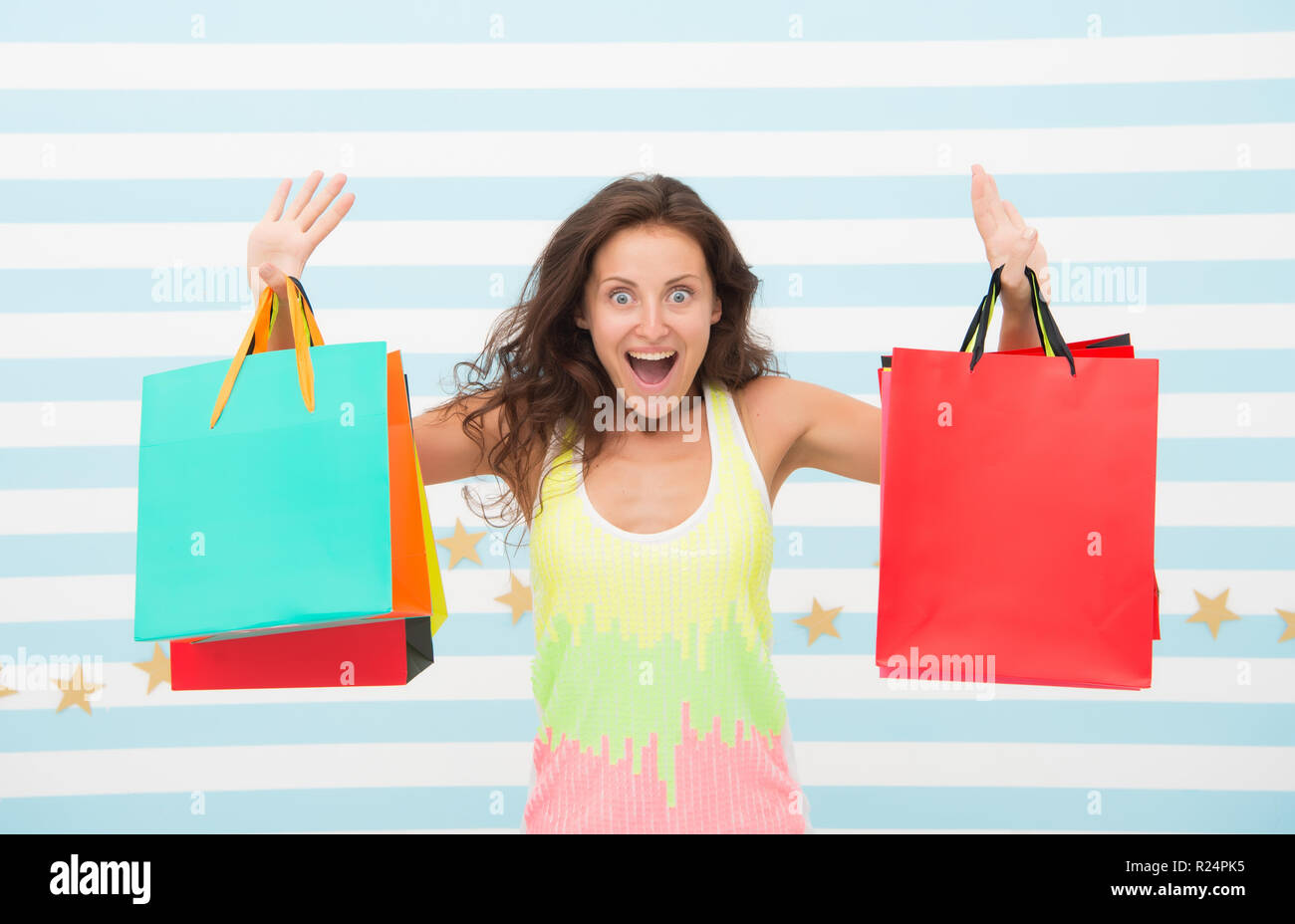 Feel free buy everything you want. Woman carries bunch shopping bags striped background. Finally bought favorite brand. Tips shop sales. Girl satisfied with shopping. Profitable purchase black friday. - Stock Image