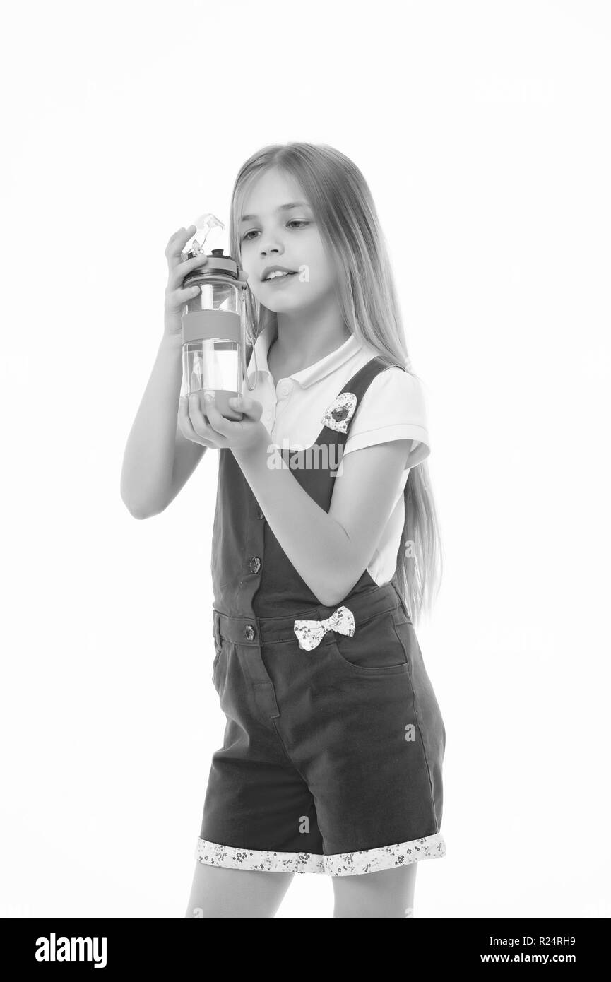 Girl hold water bottle isolated on white. Little child with plastic bottle. Only clean and fresh water. Thirst and health. Childhood. Stay hydrated and healthy. Drinking water for health. - Stock Image