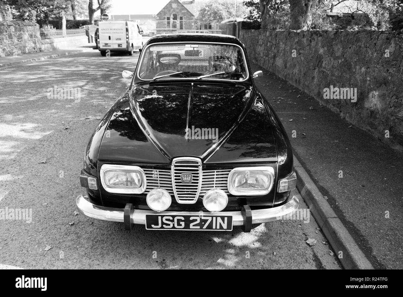 Stornoway, United Kingdom - March 19, 2010: retro automobile on asphalt road. Saab car parked on street. Transport and transportation. It is the one car I want. Wanderlust and travelling. - Stock Image