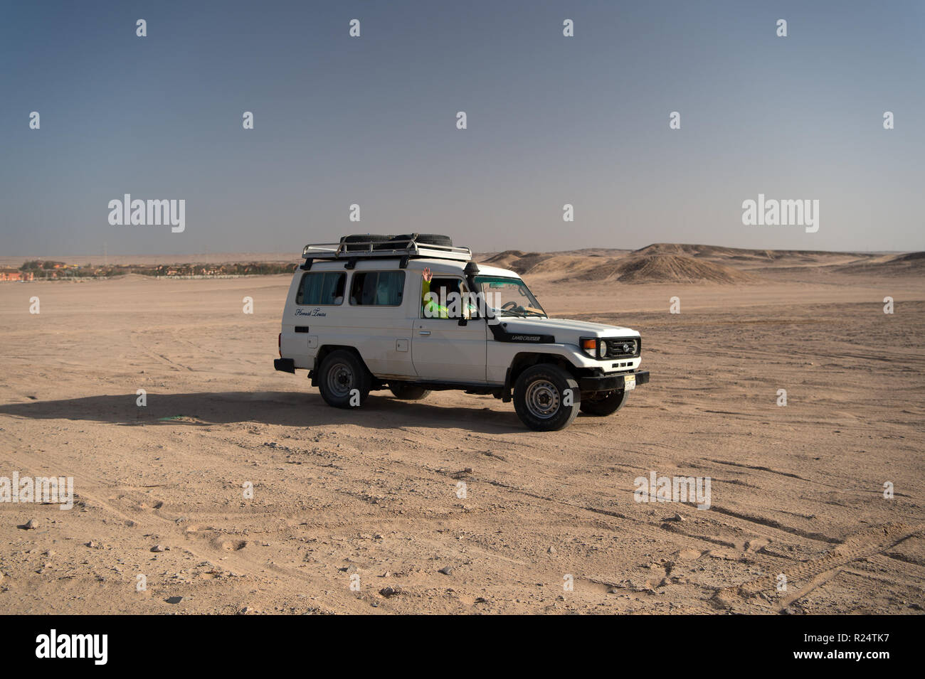 hurghada, Egypt-February 26, 2017: Desert race. Car suv overcomes sand dunes obstacles. Competition racing challenge desert. Offroad vehicle racing obstacles. Car drives offroad with clouds of dust. - Stock Image
