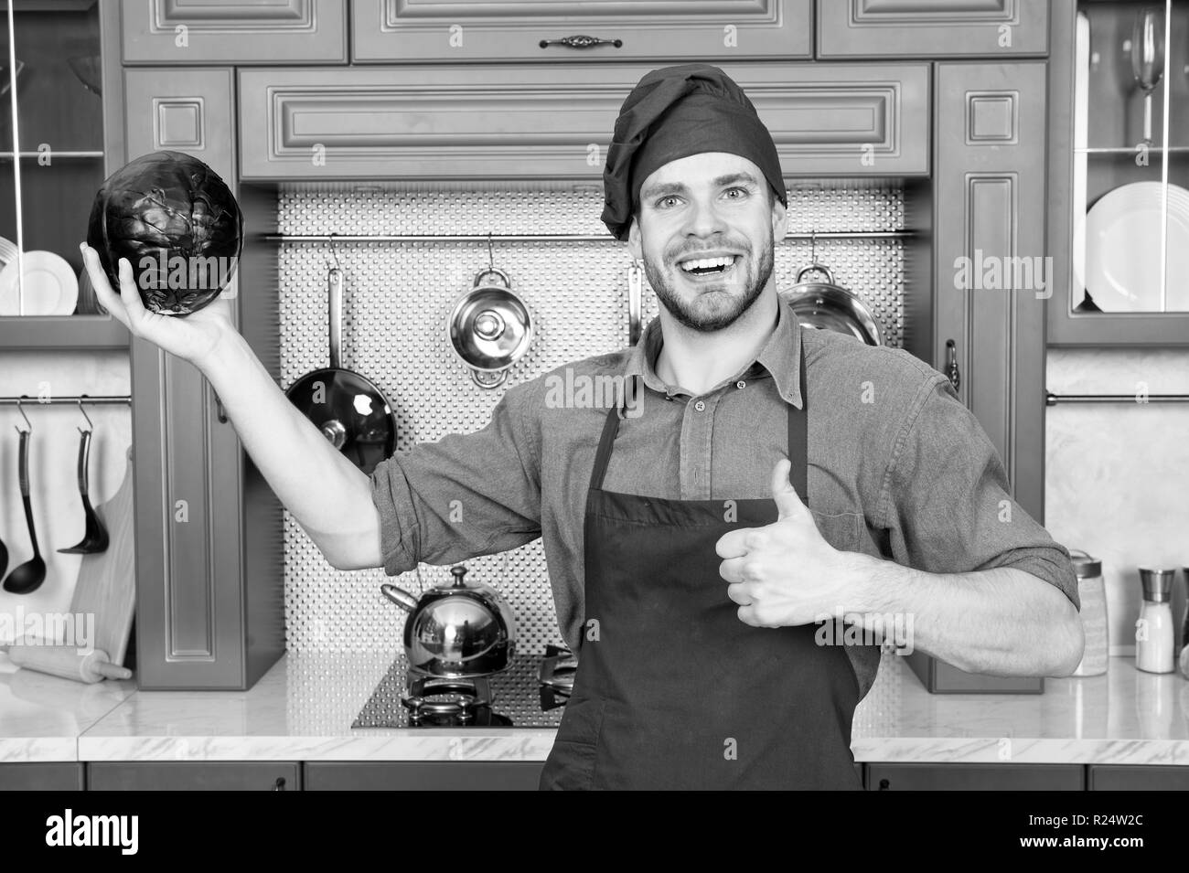 Cook in good mood. Relax put on some music. Composed cook is more efficient one. Man chef likes to cook in relaxing atmosphere. Guy professional chef feels relaxed and cheerful white cooking. Stock Photo