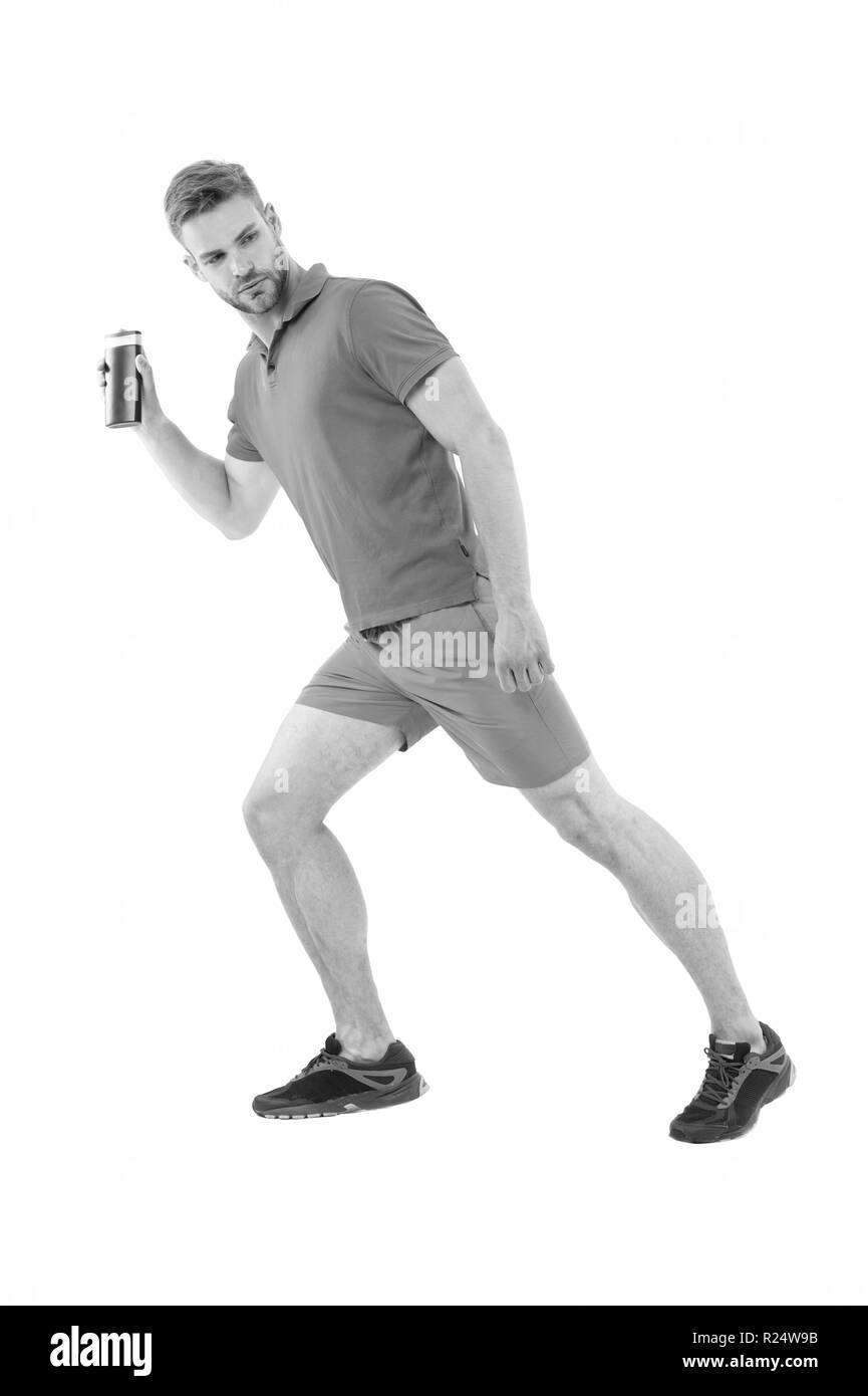 Hygiene runs the health. Man sportswear running with bottle of shower gel white background. Regular swimmer knows chlorine play havoc skin. Wash after each swimming session to prevent skin problems. - Stock Image