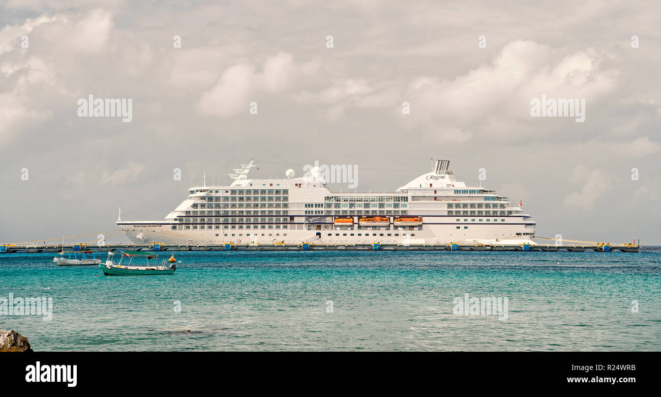 Cozumel, Mexico - December 24, 2015: large cruise ship or liner in bay or harbor, touristic passenger boat on water summer day on cloudy sky background with yachts and boats. traveling and vacation - Stock Image