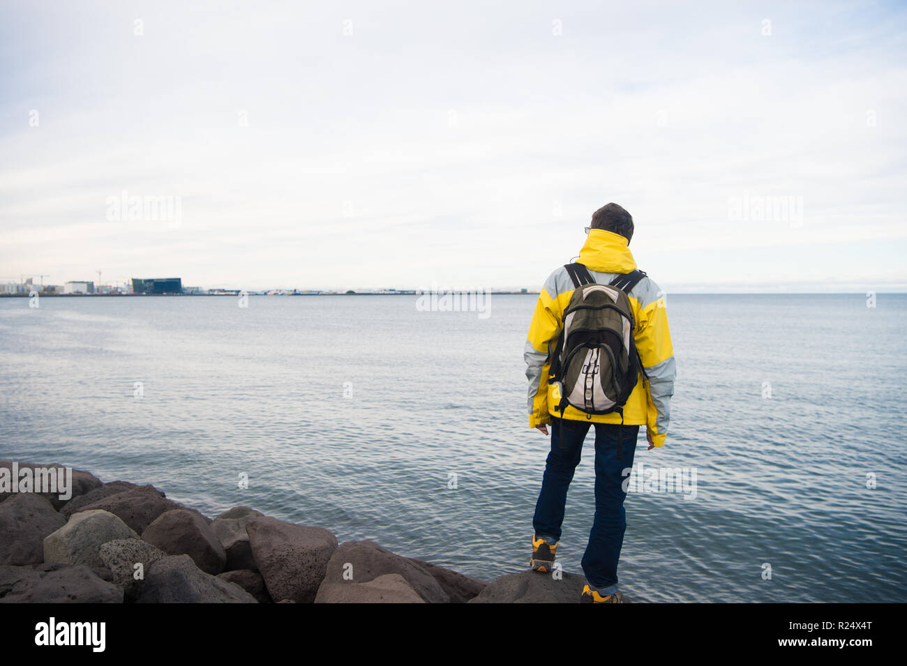 Tourist well equipment ready explore scandinavian or nordic country. Tourist traveller concept. Tourist on sea background. Man tourist wear warm protective clothes for cold climate conditions. - Stock Image