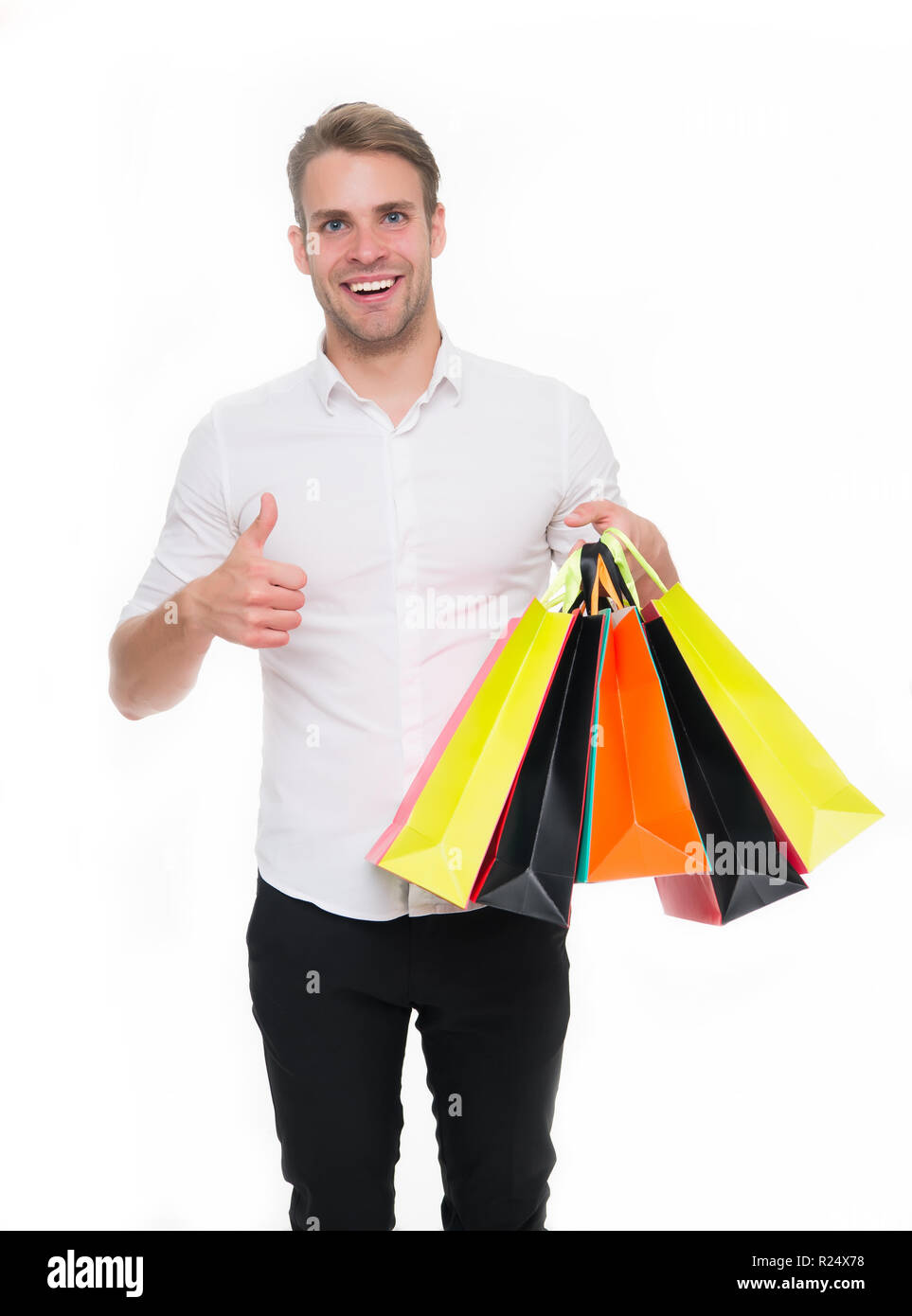 Black friday sale concept. Man formal clothes carry shopping bags. Guy happy carry bunch shopping bags. Profitable deals on black friday. Man hold lot paper bags packages after shopping in mall. Stock Photo