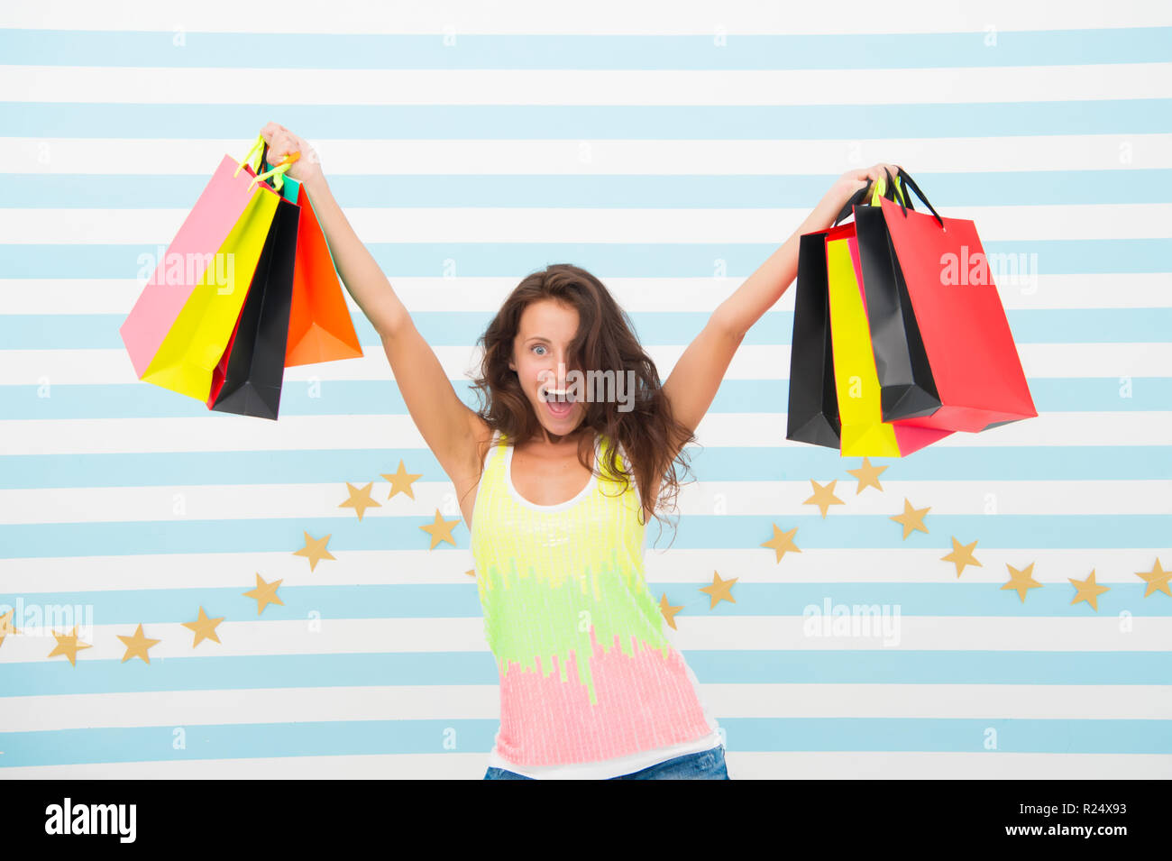 a good buy. happy girl show shopping bags. happy girl after day shopping with good buy. woman with purchase after sale. getting some retail therapy. holidays preparation of excited shopaholic - Stock Image