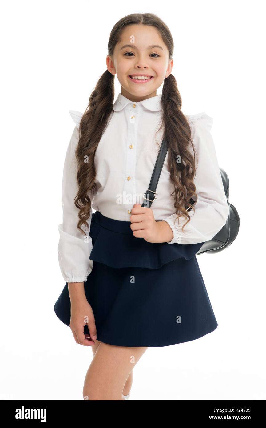 Learn how fit backpack correctly for school. Schoolgirl cute in formal uniform wear backpack. School backpack concept. Follow these tips. Right and wrong ways to wear backpack to prevent pain. - Stock Image