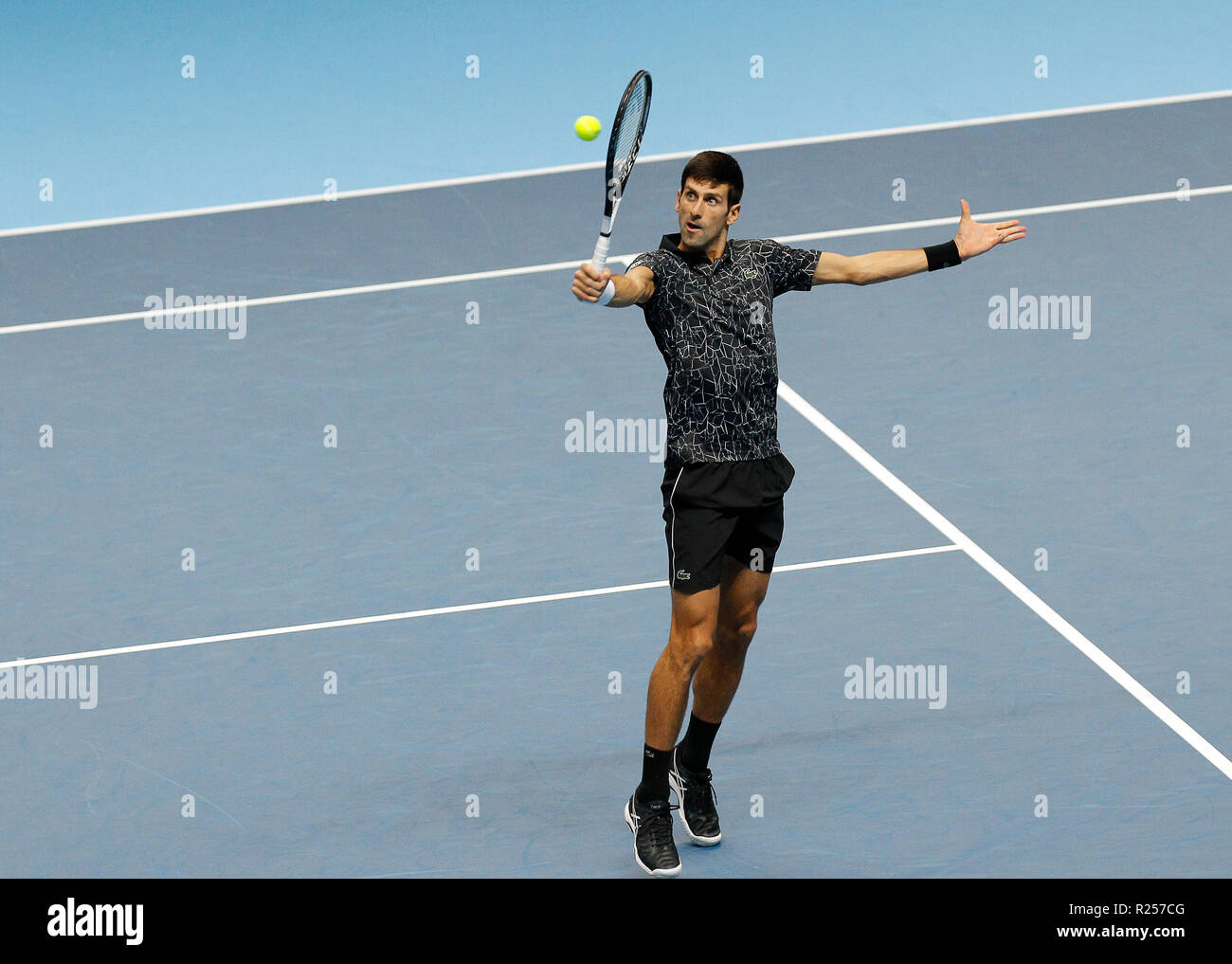 16th November 2018, O2 Arena, London, England; Nitto ATP Tennis Finals; Novak Djokovic (SRB) plays a backhand volley shot in his match against Marin Cilic (CRO) - Stock Image