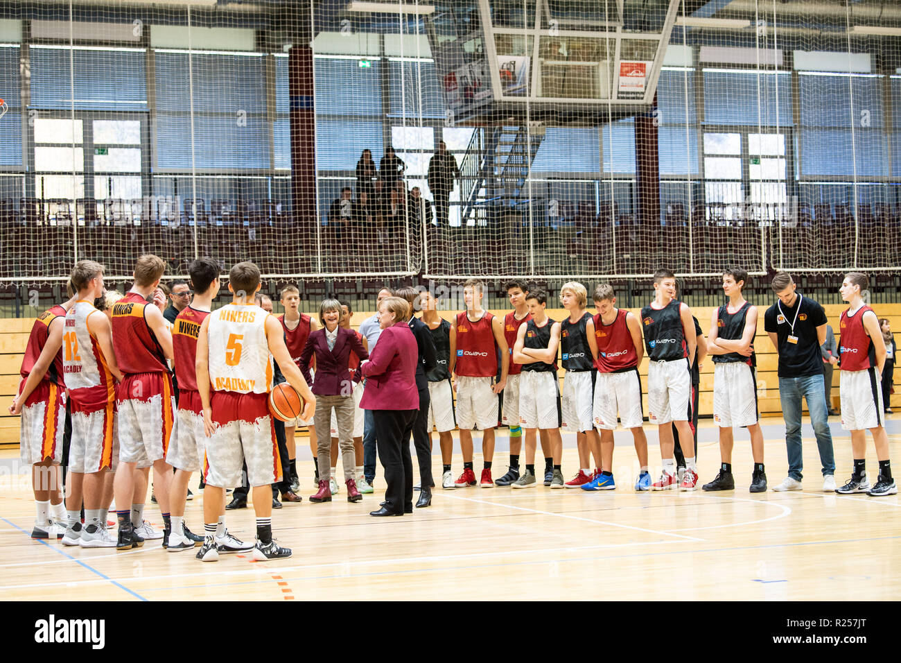 Chemnitz, Germany. 16th Nov, 2018. German Chancellor Angela Merkel (C) talks with members of the basketball club Niners Chemnitz during her visit in Chemnitz, eastern Germany, on Nov. 16, 2018. Angela Merkel on Friday clarified her refugee policy during her visit to Chemnitz, a place regarded as the center of several severe xenophobic protests months ago. Credit: Kevin Voigt/Xinhua/Alamy Live News - Stock Image