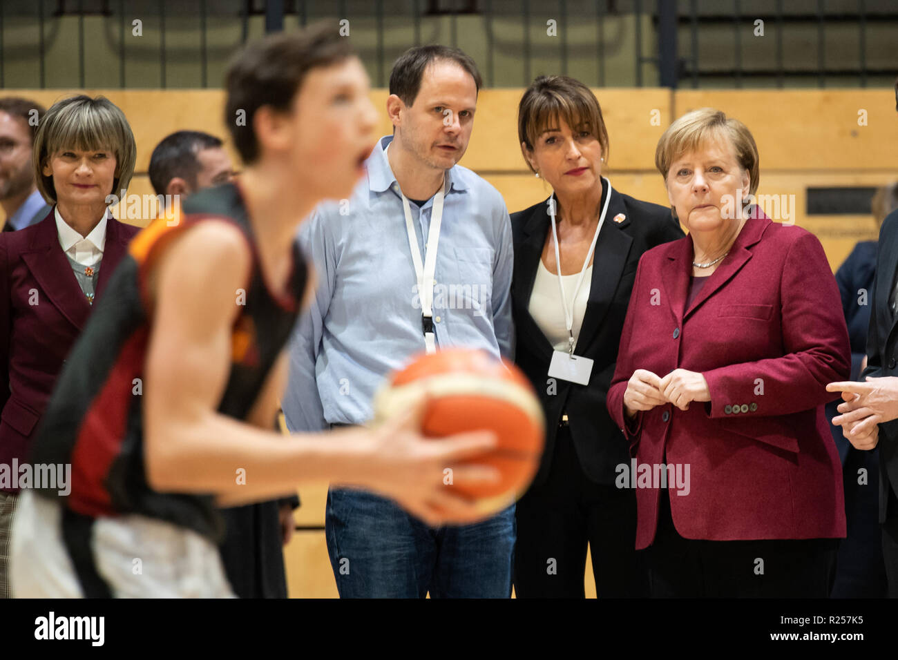 Chemnitz, Germany. 16th Nov, 2018. German Chancellor Angela Merkel (1st R) watches the training of the basketball club Niners Chemnitz during her visit in Chemnitz, eastern Germany, on Nov. 16, 2018. Angela Merkel on Friday clarified her refugee policy during her visit to Chemnitz, a place regarded as the center of several severe xenophobic protests months ago. Credit: Kevin Voigt/Xinhua/Alamy Live News - Stock Image