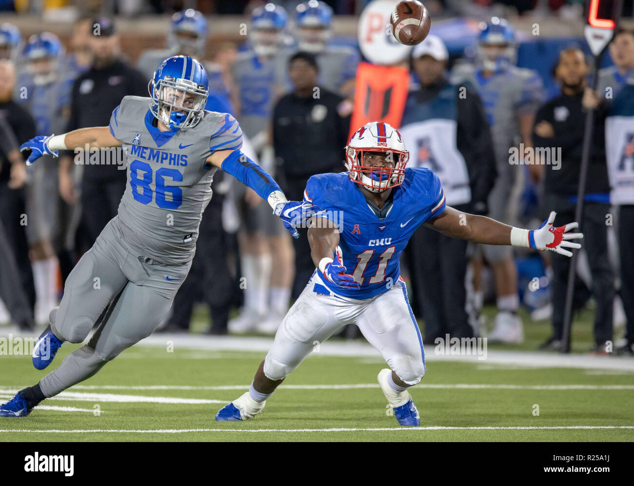Dallas, Texas, USA. 16th Nov, 2018. SMU's Kyran Mitchell #11 and Memphis' Joey Magnifico #86 both dive for a tipped ball during the NCAA Football game between the SMU Mustangs and the Memphis Tigers at Gerald J. Ford Stadium in Dallas, Texas. Kyle Okita/CSM/Alamy Live News Stock Photo