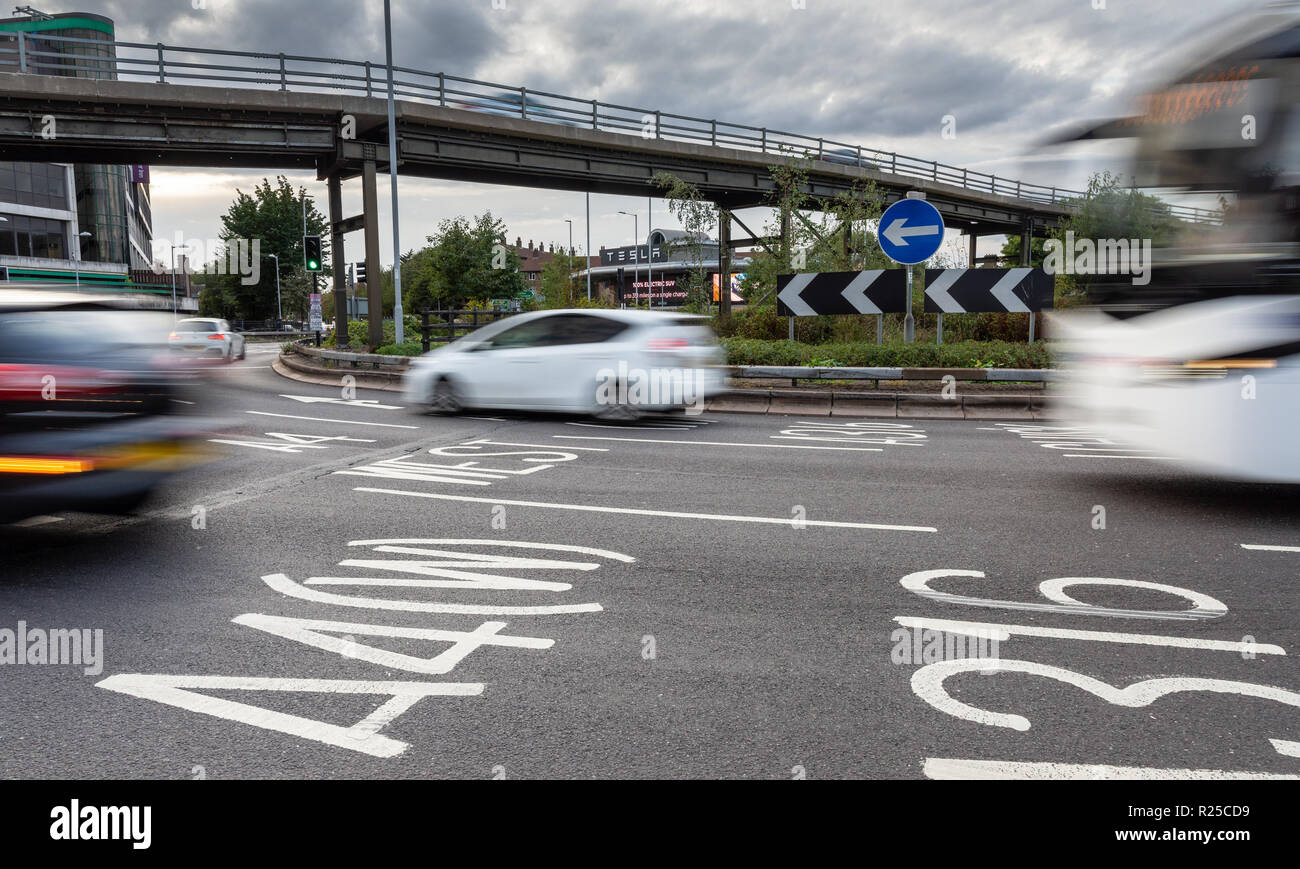 London, England, UK - September 9, 2018: Traffic speeds through the Hogarth roundabout and flyover junction at Chiswick in West London. - Stock Image