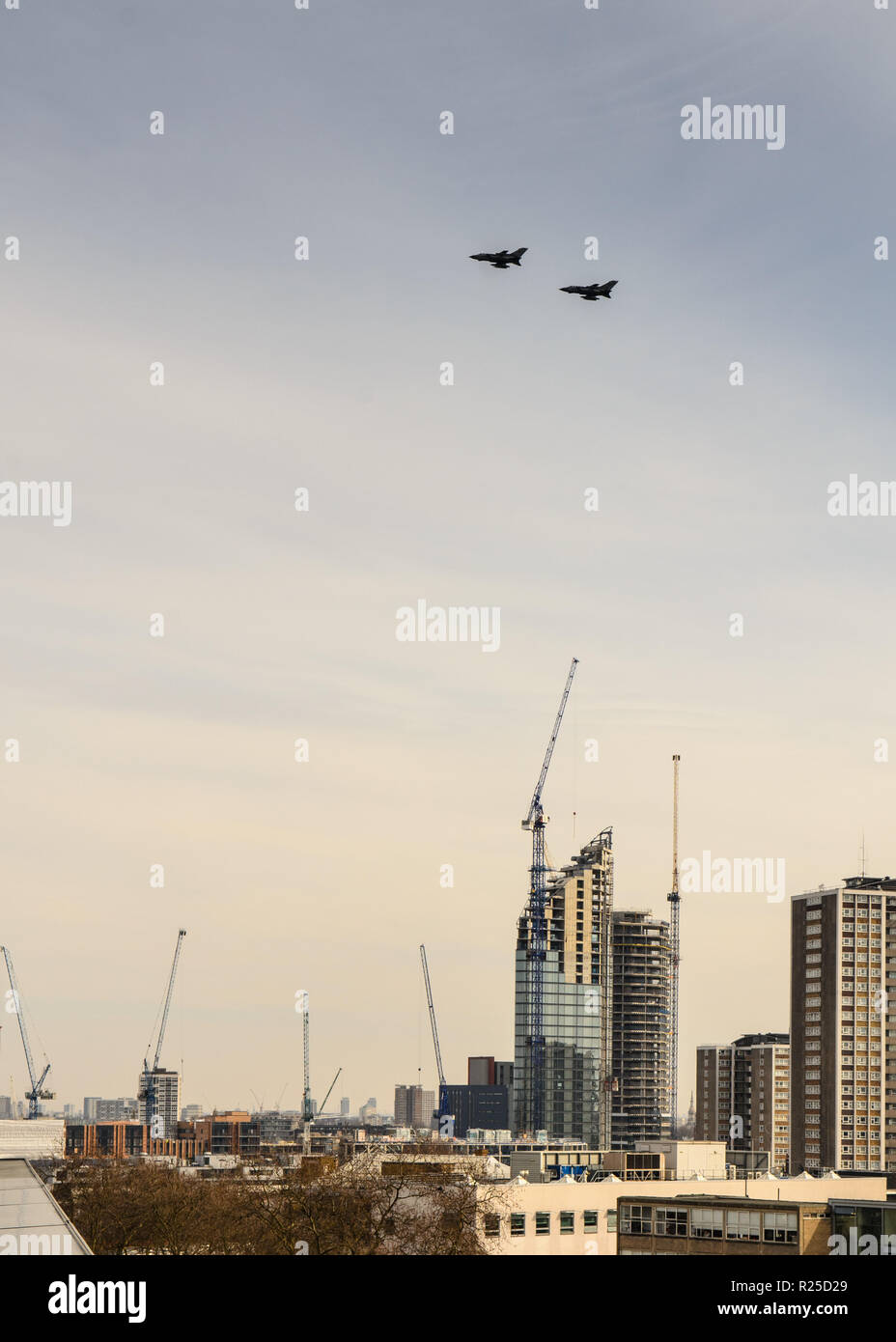 London, England, UK - March 13, 2015: Fighter jets race over North London as part of a commemorative flypast. - Stock Image