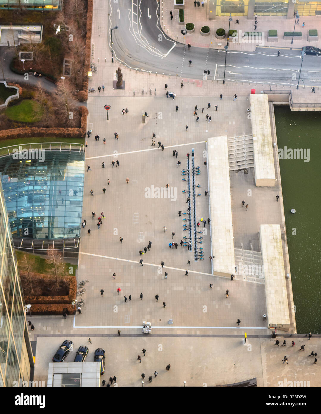 London, England - February 27, 2015: Commuters and pedestrians in Reuters Plaza outside Canary Wharf Jubilee Line tube station in the Docklands busine Stock Photo