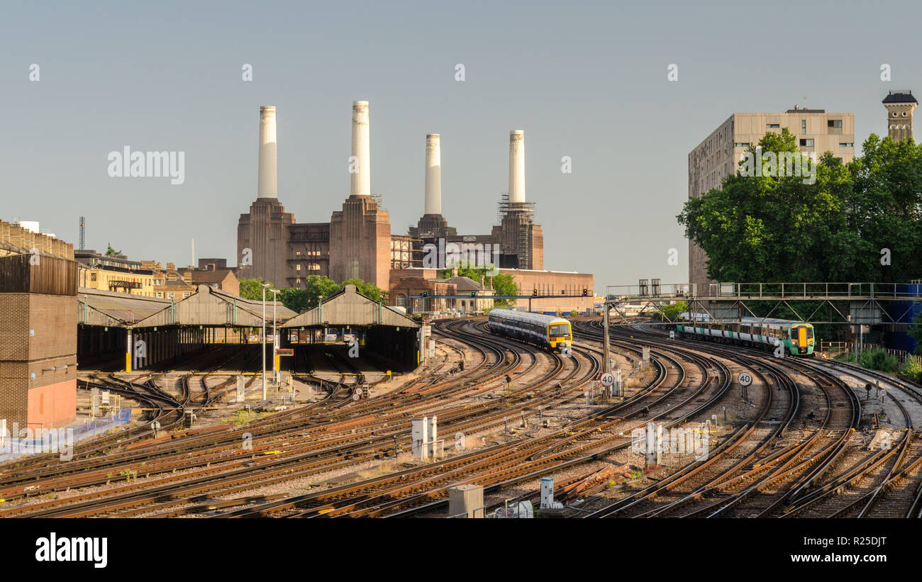London, England, UK - July 9, 2013: Southern and Southeastern electric multiple unit commuter passenger trains approach London's Victoria Station, wit - Stock Image
