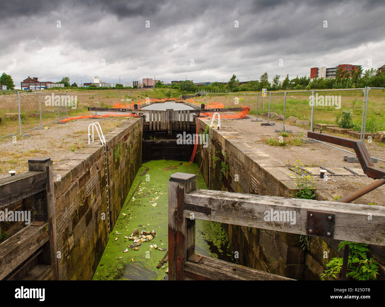 Salford, England, UK - June 16, 2012: Rubbish gathers in what remains of the Manchester Bolton & Bury Canal during regeneration of wasteland in centra - Stock Image