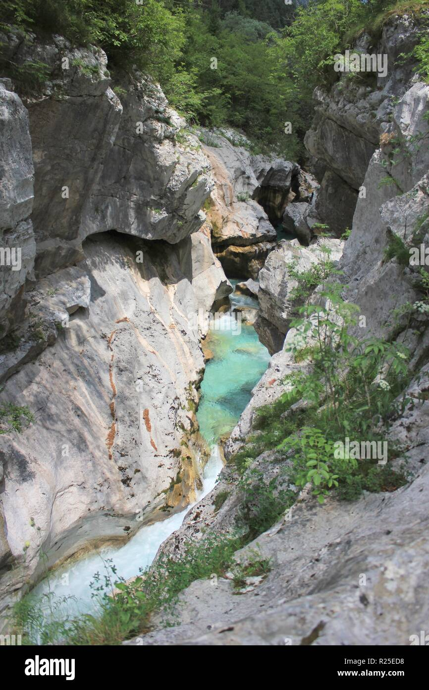 Deep narrow riverbed of Soca river, Triglav National Park, Julian Alps, Alpe Adria trail, Slovenia, central Europe - Stock Image