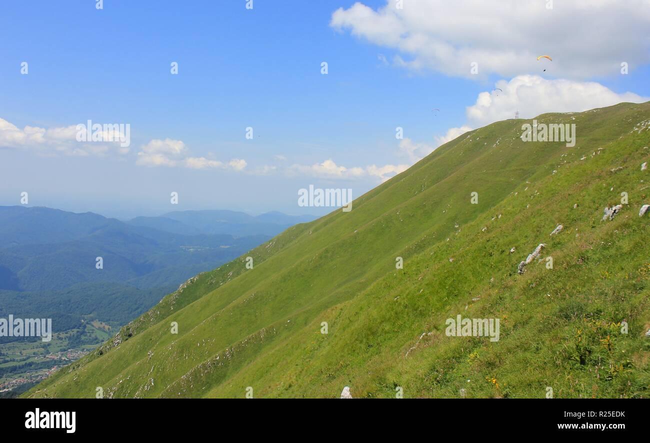 Green slopes of Kobariski Stol, popular paragliding site, Julian Alps,  Alpe Adria trail, Slovenia, central Europe - Stock Image