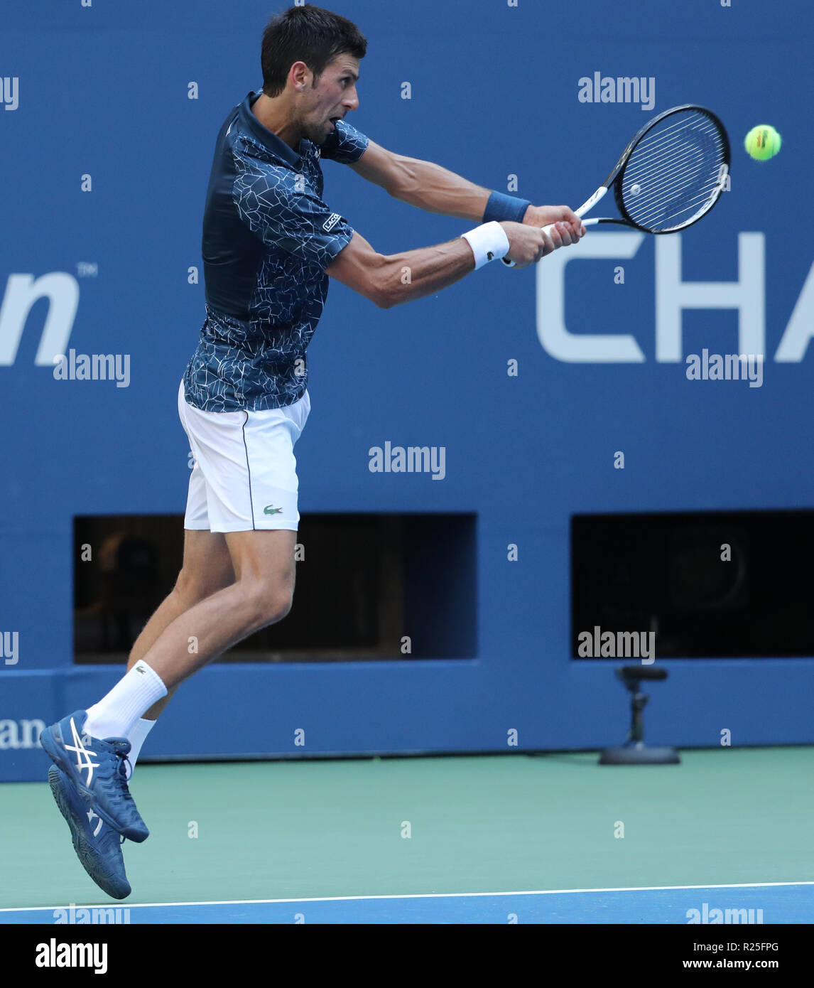 13-time Grand Slam champion Novak Djokovic of Serbia in action during his 2018 US Open round of 16 match at Billie Jean King National Tennis Center - Stock Image