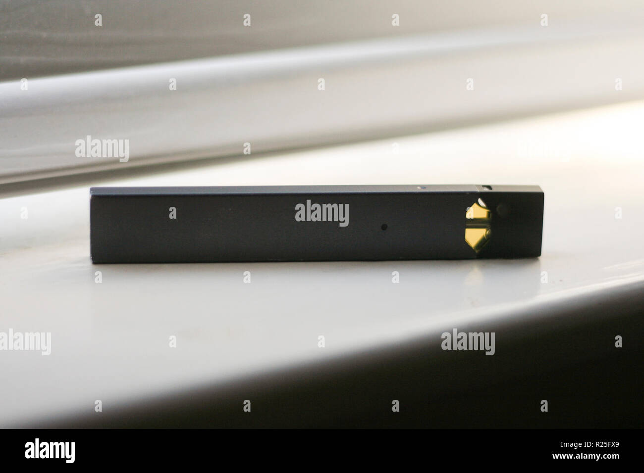 JUUL E-Cigarette and Flavor Pods on white background Stock Photo