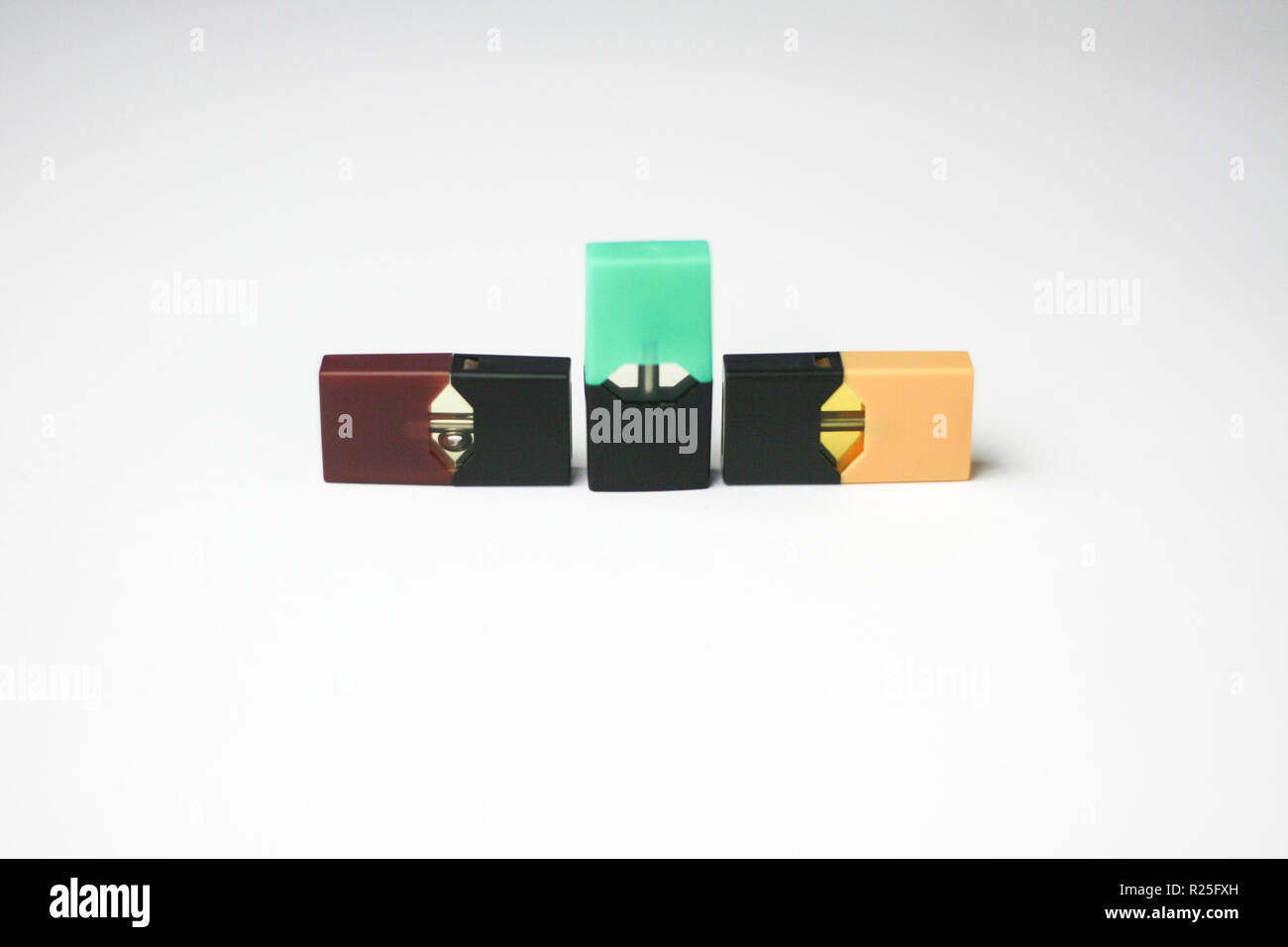JUUL E-Cigarette and Flavor Pods on white background Stock