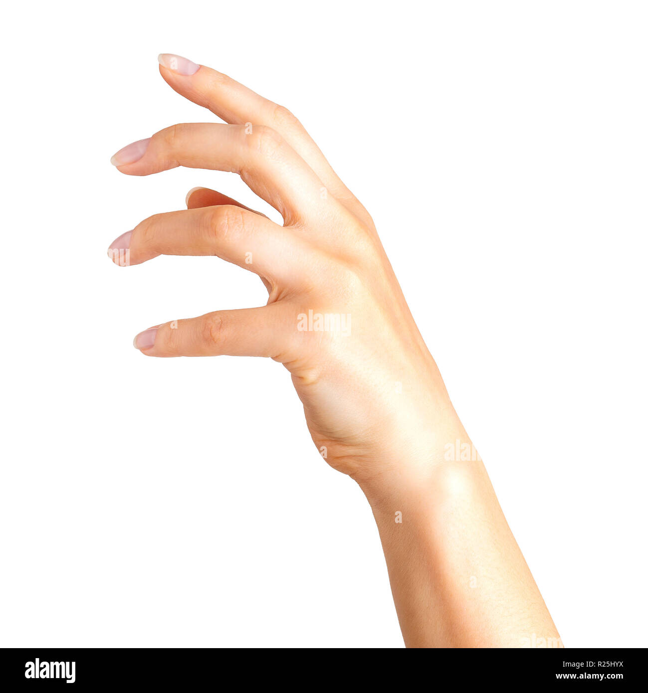Woman hand with crooked fingers showing magic trick or holding ball - Stock Image