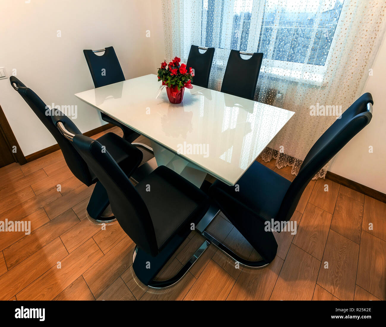 White Wooden And Glass Round Dining Table With Six Chairs ...