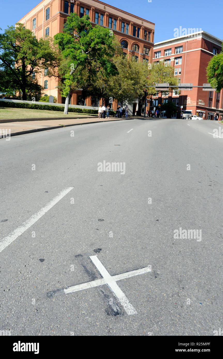 An 'X' on Elm Street in Dealey Plaza marks the spot where John  Kennedy was hit by a bullet fired by Lee Harvey Oswald from the Texas Book Depository. - Stock Image
