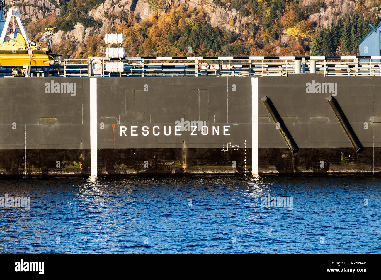The side of offshore supply vess Olympic Energy, with the rescue zone marked. Ship is berthed at Skoltegrunnskaien quay in the port of Bergen, Norway. - Stock Image