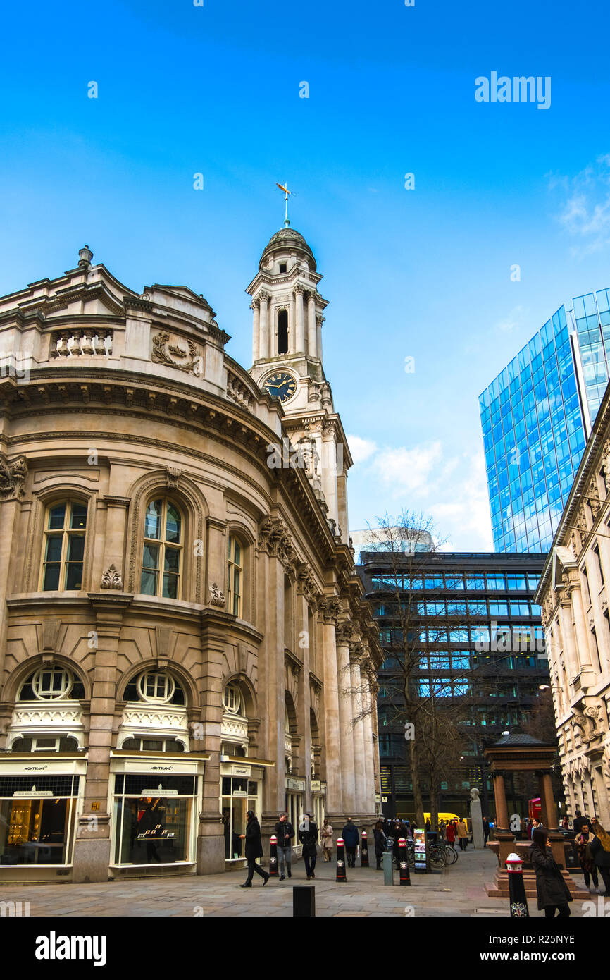 LONDON. ENGLAND - March 20 2018: City life in the Royal Exchange area. Luxurious shops and a mixture of old and new buildings. - Stock Image