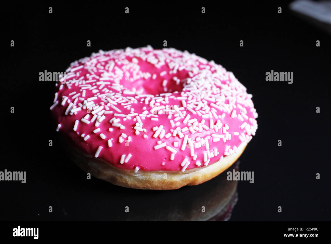 Pink donut. Donuts stock photo - Stock Image