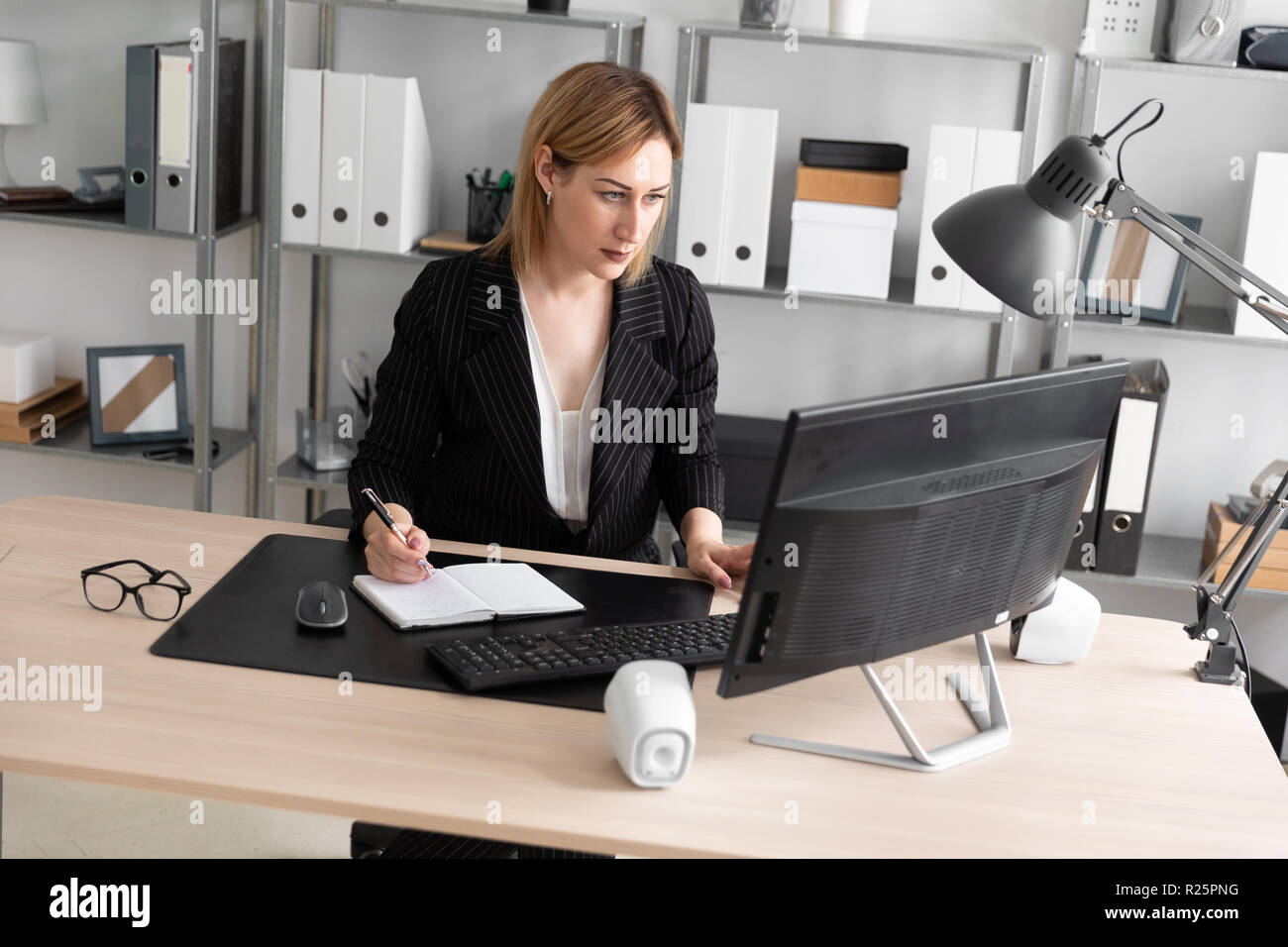 Young girl working in the office. - Stock Image