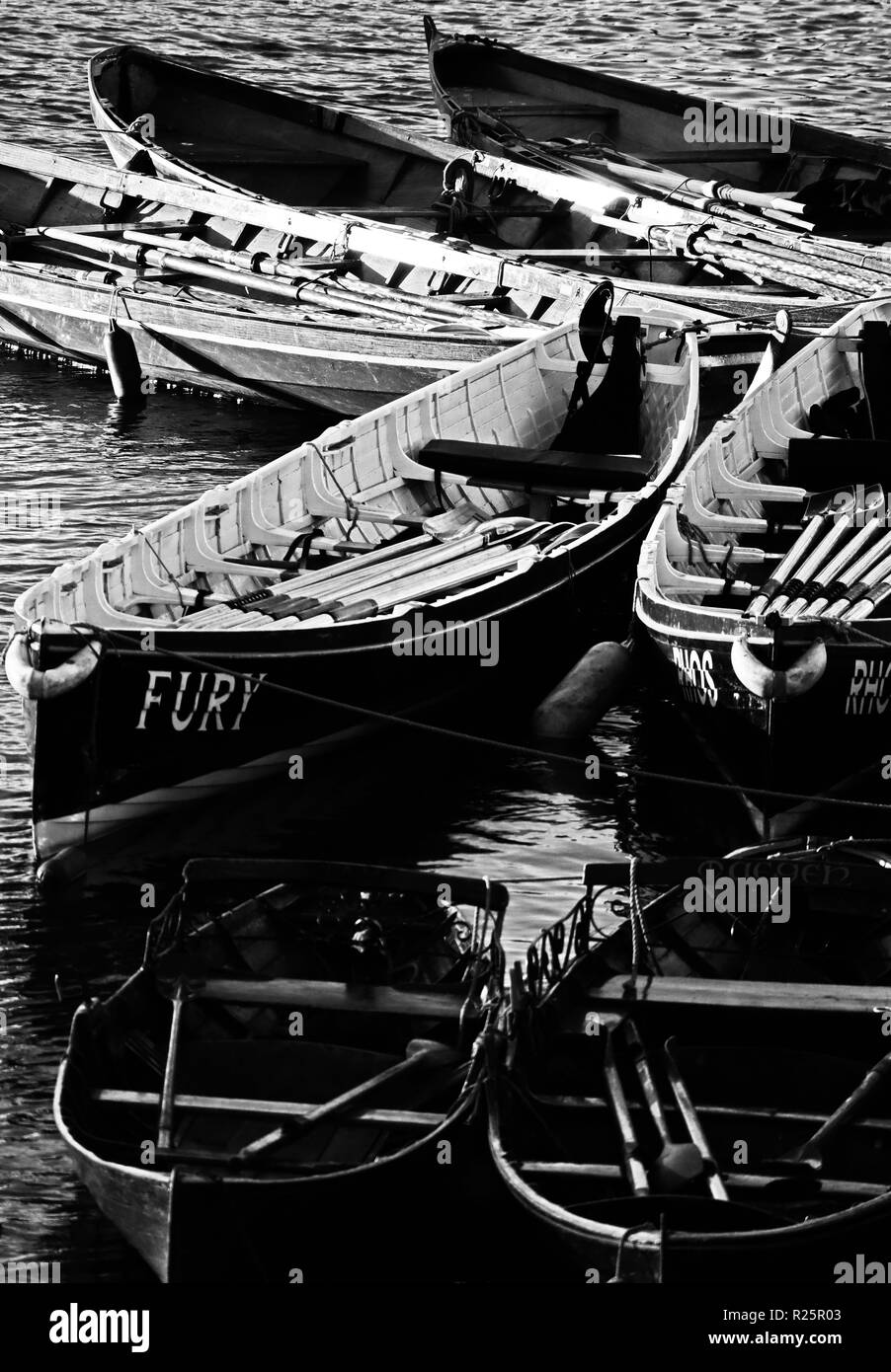 An abstract image depicting a selection of Cornish Gigs and other rowing boats moored on the River Thames at Richmond Upon Thames, England - Stock Image
