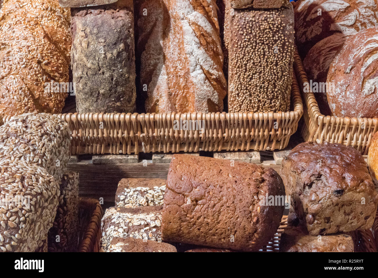 a selection or variety of loaves wholemeal, white and granary at an artisan bakery at borough market in london. - Stock Image