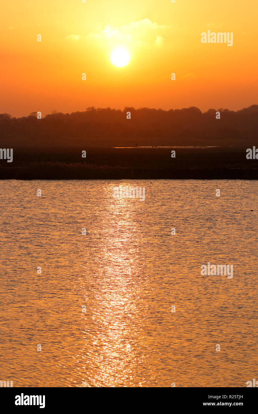 The sun setting over RSPB St Aidan's in Leeds, West Yorkshire. - Stock Image