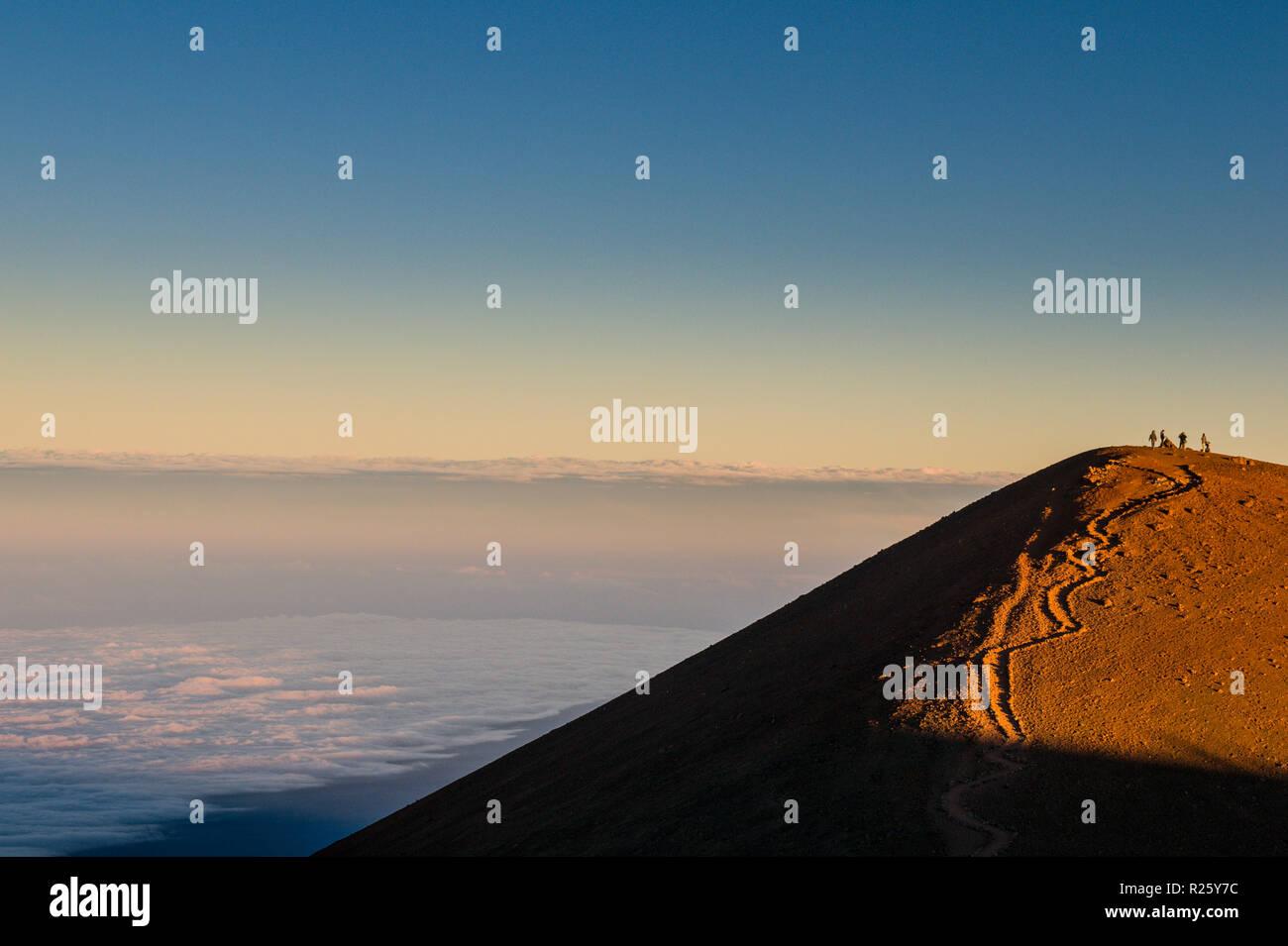 Tourists on a volcanic cone on top of Mauna Kea, Big Island, Hawaii, USA - Stock Image