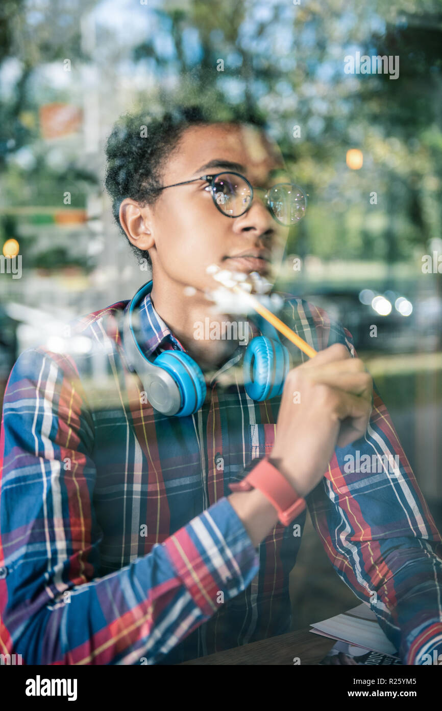 Pleasant nice man looking for new ideas - Stock Image