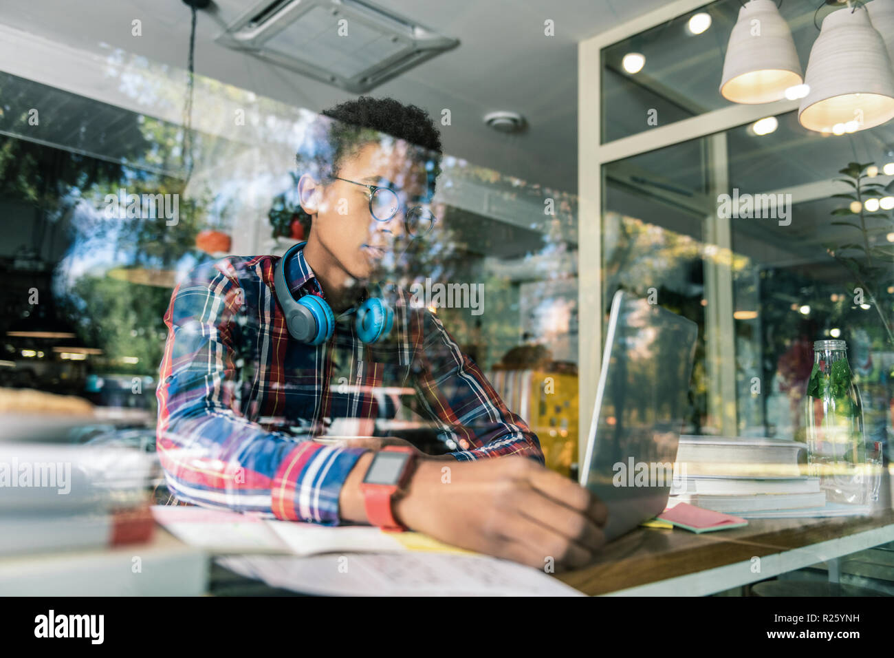 Smart Afro American man looking at the laptop screen - Stock Image