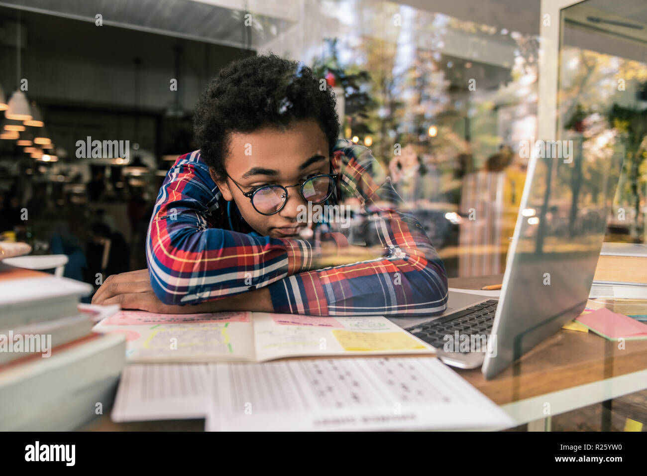 Sad unhappy student thinking about the exam - Stock Image