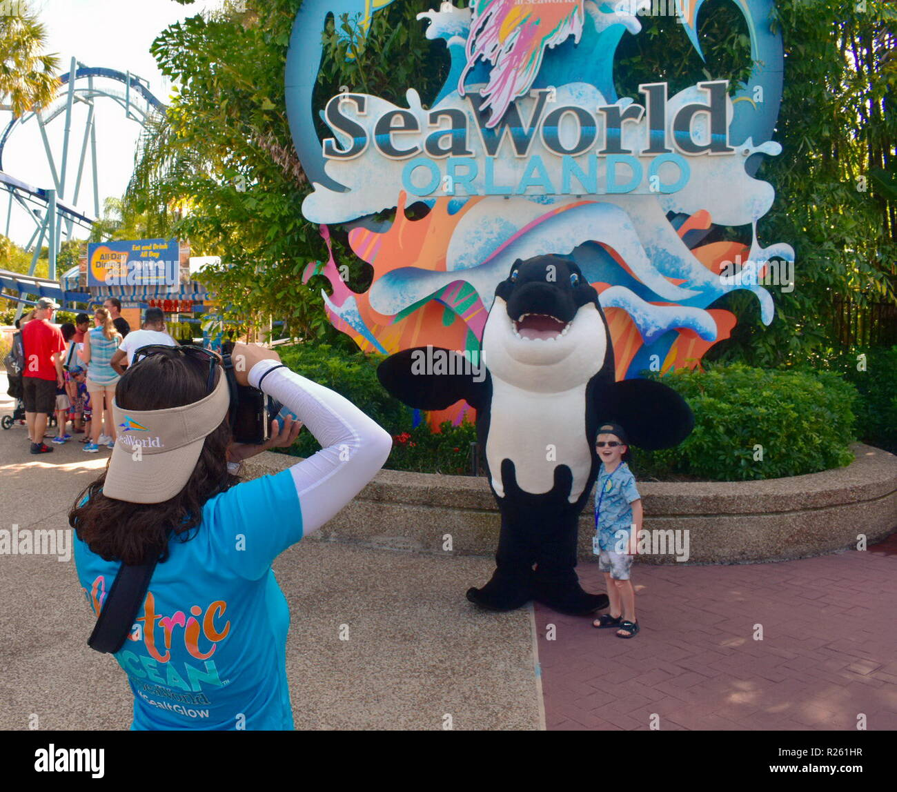 Orlando, Florida. October 26, 2018  Girl taking picture of nice boy with whale character at Seaworld Theme Park. - Stock Image