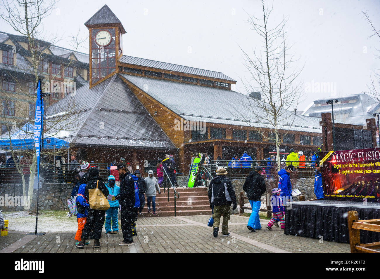 March 24, 2018 South Lake Tahoe / CA / USA - People gatheres around the Heavenly Ski Gondola starting point on a morning with heavy snowing Stock Photo