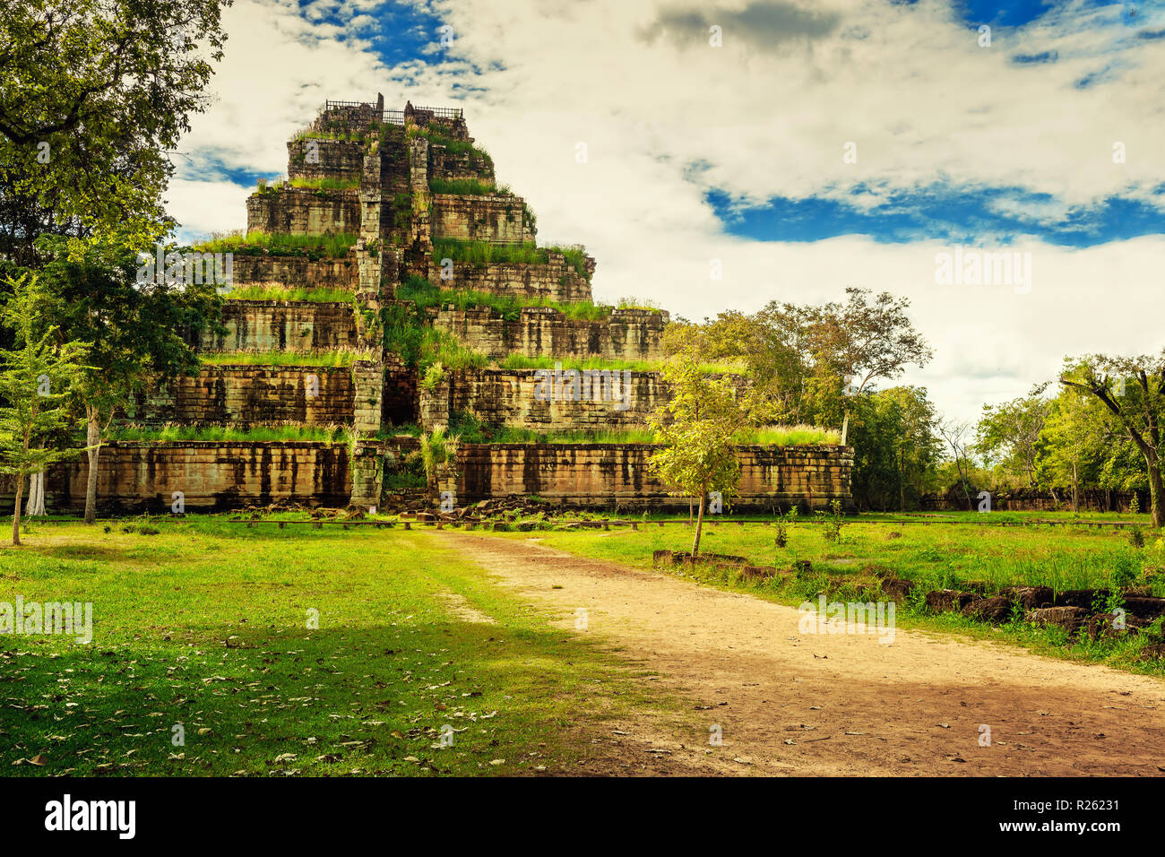 Ancient pyramid death Prasat Thom Koh Ker in Mayan style hidden in tropical rainforest jungle of Cambodia - Stock Image