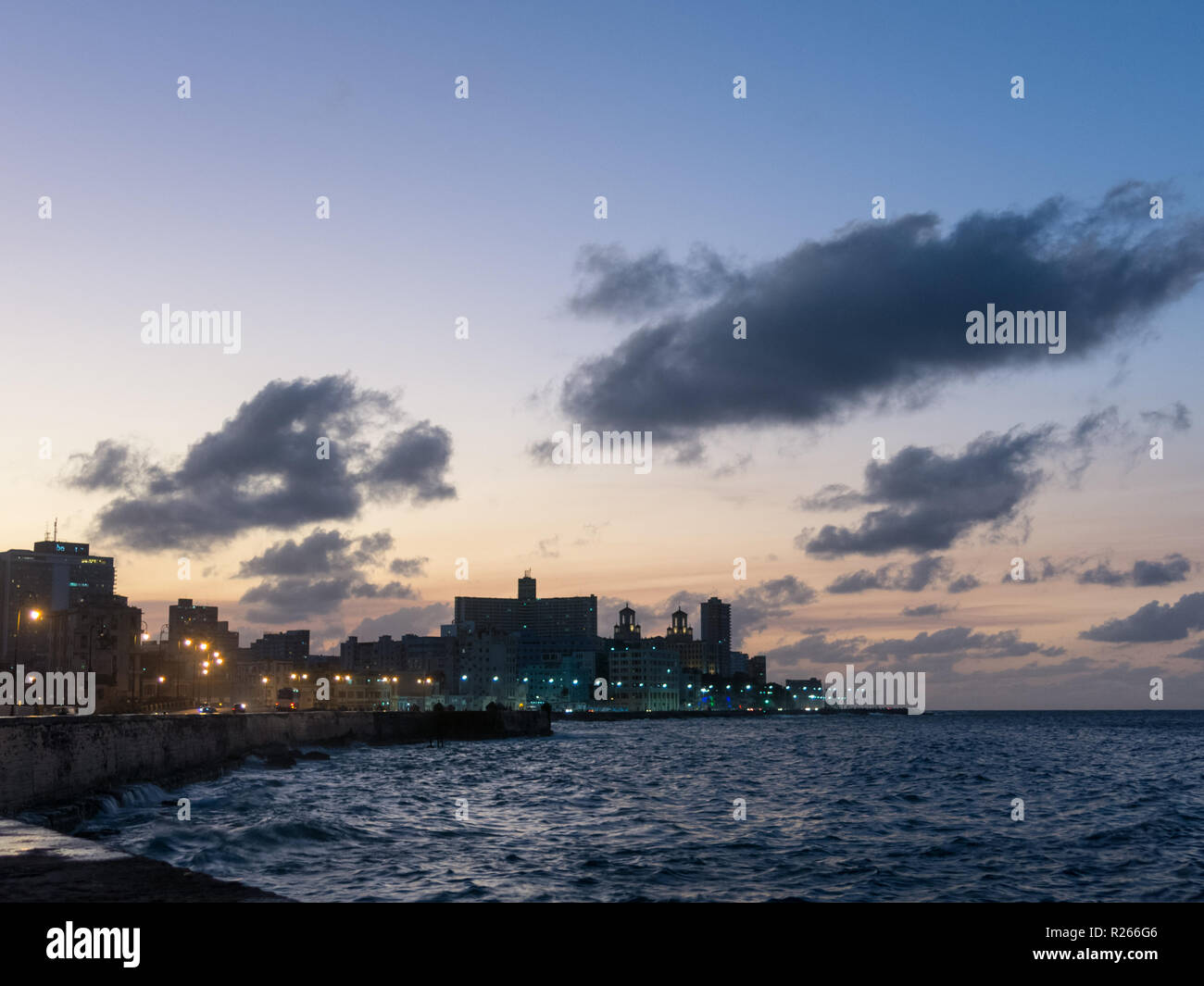 Sunset at Malecon, the famous Havana promenades where Habaneros, lovers and most of all individual fishermen meet, Havana, Cuba - Stock Image