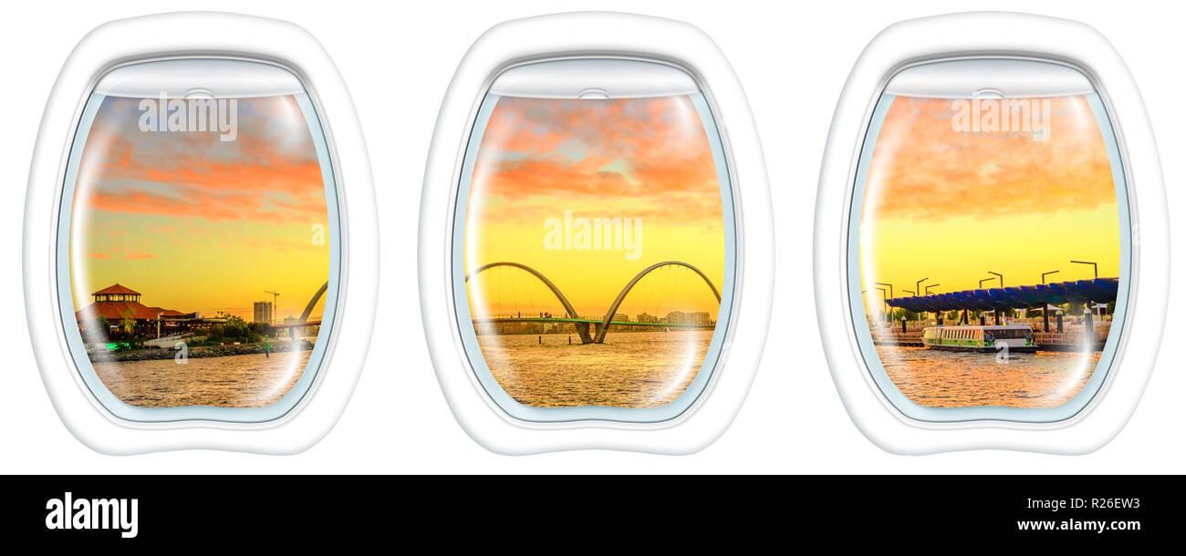 Three plane windows on Quay Bridge on Swan River in Elizabeth Quay marina at sunset. Scenic flight above Perth, Western Australia skyline, from a plane on the portholes windows. Copy space. - Stock Image